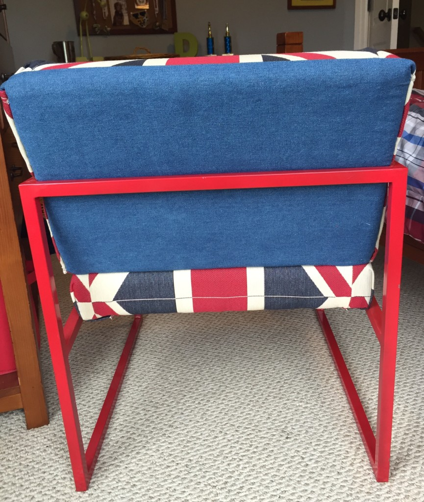 My fabric goof up...I used a coordinating piece of denim to cover the back of the chair.