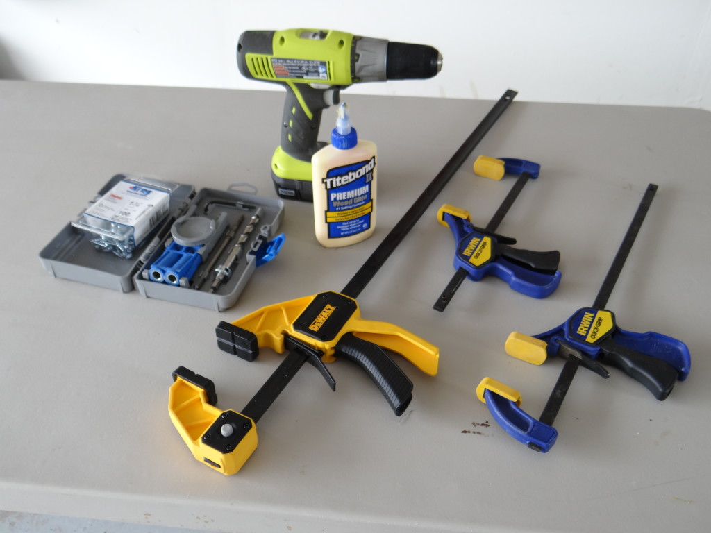A few of the tools needed to build the rustic x console: cordless drill, kreg jig, wood glue, and clamps.
