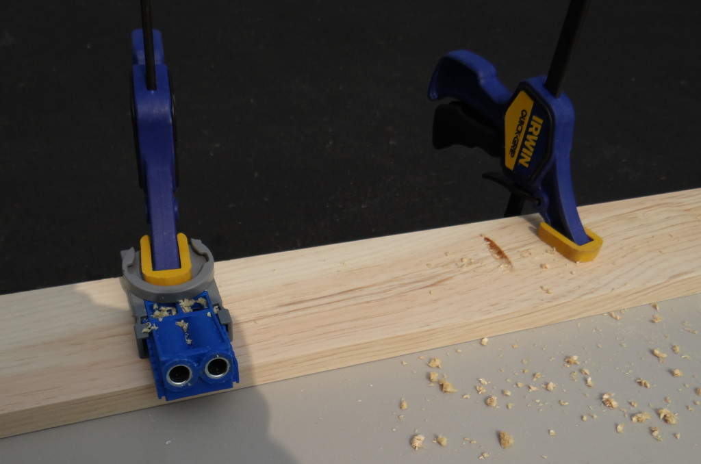 Use clamps to hold the wood to a stable working surface while you drill your pocket holes.